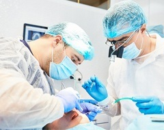 dental surgeons inserting dental implant
