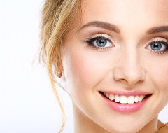 Teen girl with straight smile using Invisalign.