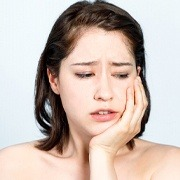 woman with jaw pain from teeth grinding in Oklahoma City